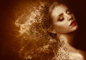 Golden Splatter. Futuristic Woman With Bronzed Painted Skin. Fantasy