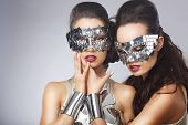 Masquerade. Artistic Women In Fancy Bright Glasses