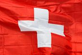 Swiss Flag In Wind In The Sunlight