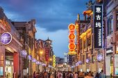 GUANGZHOU, CHINA - MAY 25, 2014: Pedestrians pass through Shangxiajiu Pedestrian Street. The street