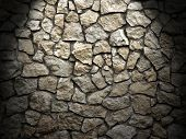 Old Grunge Wall Of Rough Stones As Background , Light Effect