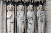 PARIS, FRANCE - NOV 05, 2012: King, Queen of Sheba, King Solomon and St Peter, details of Notre Dame cathedral. Portal of St. Anne was the first of the three west portals to be installed (c.1200).