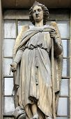 PARIS, FRANCE - NOV 09, 2012: Archangel Raphael, architectural details of Eglise de la Madeleine. Ma