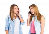 Young Girls Talking To Mobile Over White Background