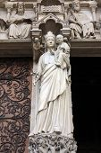 PARIS, FRANCE - NOV 05, 2012: Madonna with Child, architectural detail of Notre Dame cathedral. The