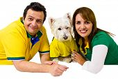 Brazilian couple supporters with a pet on white background