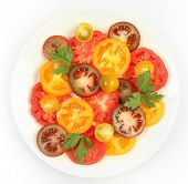 Ripe tomatoes on white table