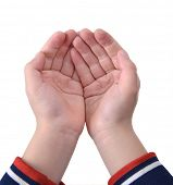 Open child hands in front of bright white backgrounds.