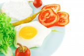 fried eggs with curd and salad on blue plate