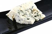 french blue soft cheese on black plate