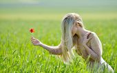 Beautiful girl on cereal field in summer sunny day
