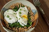 picture of sauteed  - Poached eggs served over fresh sauteed spinach leaves and farro - JPG