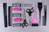 Professional hairdresser tools  on gray background