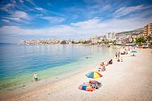 SARANDA, ALBANIA - JUNE 08, 2014: Unidentified tourists on pablic beach on  June 08, 2014 in Saranda