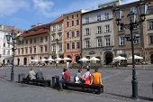 KRAKOW, POLAND - SEPTEMBER 15, 2013: People resting on the Little Market square. This square sometim
