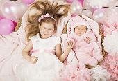 Baby Birthday Party Gifts. Girl Holding Newborn Sister Hand. Child Sleeping In Basket. Invitation Ca