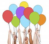 Multi-Ethnic Group of Hands Holding Ballons