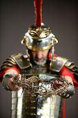 Roman soldier holding crown of thorns - With selective focus on foreground