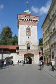 KRAKOW, POLAND - SEPTEMBER 15, 2013: People under the St. Florian's Gate. Built in XIV century as a rectangular Gothic tower of wild stone, it's the main gate of the medieval Krakow