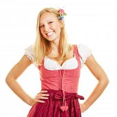 Smiling happy blond woman in dirndl dress for the Oktoberfest