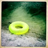 Instagram filtered image of a donut floatation