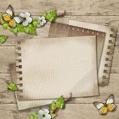 Blank Paper With Blossoming Cherry Branch And Butterfly  On Wooden Background
