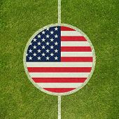 Football field center closeup with American flag in circle