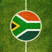 Football field center closeup with South African flag in circle