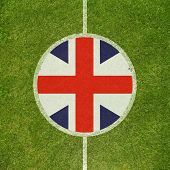 Football field center closeup with British flag in circle