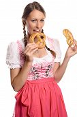 Happy Young Woman In A Dirndl Eating Pretzels