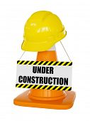 Under construction concept background - yellow hard hat on orange highway traffic construction cone