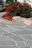 foto of stone floor  - typical stone walkway and walls with flowers greek islands - JPG