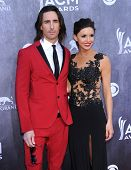 LOS ANGELES - APR 06:  Jake Owen & Lacey Buchanan arrives to the 49th Annual Academy of Country Musi