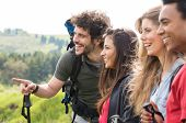 Group Of Happy Hikers Enjoying Trip In Countryside