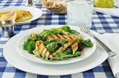 stock photo of butter-lettuce  - A grilled pear salad with several types of lettuce on a picnic table - JPG