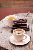 Hot Tea And Chocolate Cake And  Espresso