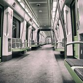 Inside a green empty subway car with filter effects.