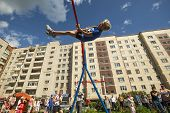 TIKHVIN, RUSSIA - JULY 7, 2014: Unidentified participants city competitions in Street workout timed