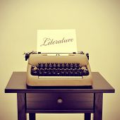 an old typewriter with a page with the word literature written in it, with a retro filter effect