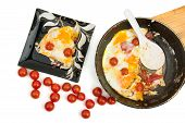 Eggs With Cherry Tomatoes In A Pan