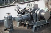 Closeup Photo Of Bow Anchor Winch On Ship Deck