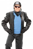 Mature biker with leather jacket posing on white background