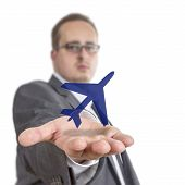 stock photo of float-plane  - Business man reaches out his arm with an aircraft symbol floating over his hand. Isolated on White Background ** Note: Shallow depth of field - JPG