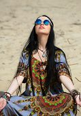 hippie girl meditates on a beach
