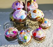 Multicoloured cupcakes on a metal stand