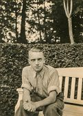 GERMANY, CIRCA FORTIES - Vintage portrait of man on bench