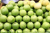 A bunch of fresh ripe guavas stacked for sale