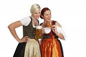 Two Bavarian Girls With Beer In Traditional Costumes