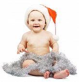 Child in Santa Claus red hat with silver tinsel