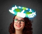 Teenager with cloud social icons around her head